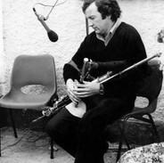 A rapt Marty Vaughan listens to Liam Ó Floinn's piping.