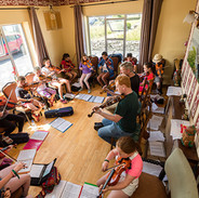 Johnny Kelly and Darach O'Connor with their young fiddle students.