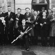 The Tulla Céilí Band pictured after winning the 1947 Oireachtas na Mumhan Prize with (l. to r.)  P. Joe Hayes, Francie Donnellan, Paddy Canny, Paddy O'Donoghue (seated), Seán Reid (holding cup), Jack Murphy, Jim O'Donoghue and Willie Clancy.  Photo courtesy of NPU.