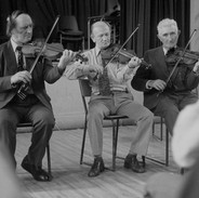 John Kelly, Bobby Casey and Junior Crehan playing in the fiddle recital, 1977.