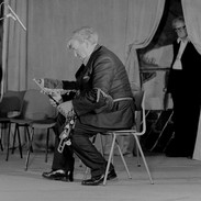 Martin Rochford performing at the 1982 uilleann pipes recital with Breandán Breathnach looking on.