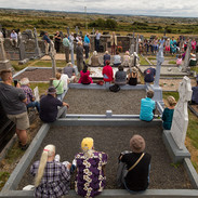Séan Garvey (cream jacket) singing at the graveside tribute to Willie Clancy.