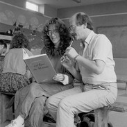 Darach de Brún (right) plays a tune for one of his whistle students, 1985.