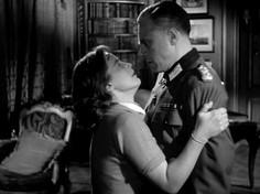 Maria Schell as Nicole de Malvines and Marius Goring as Colonel Günther von Hohensee