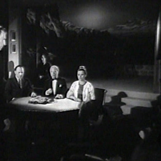 Michael Rennie as Harry Lime, David Bauer as Tellini, John Crawford as Baird, Marius Goring as Dimonella, Joanna Dunham as Nina and Oliver Reed as Pepi in The Third Man Season 5 Episode 1 'A Question in Ice'. When the body of Italian partisan who was last seen with Harry Lime during World War II is discovered at the end of a glacier, Harry returns to the Alps to face retribution from the agent's former compatriots. Broadcast 27 June 1964