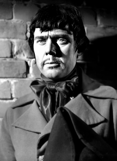 Marius Goring as Sir Percy Blakeney/The Scarlet Pimpernel in disguise