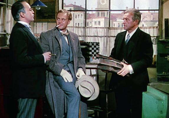 Herbert Lom as Julius de Koster, Claude Rains as Kees Popinga and Marius Goring as Inspector Lucas