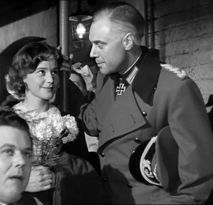 Maria Schell as Nicole de Mavines and Marius Goring as Colonel Günther von Hohensee