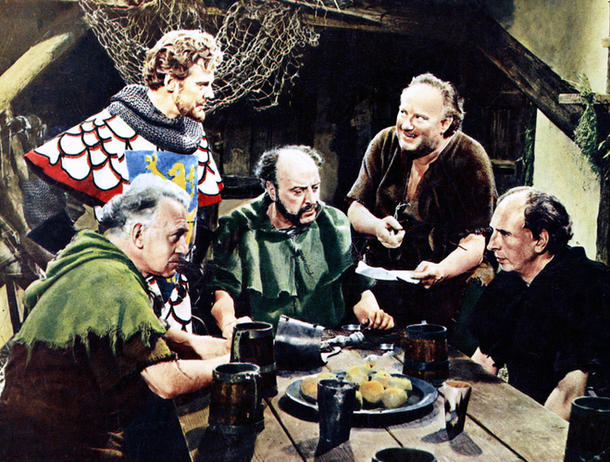Standing: Marius Goring as the Earl of Chester, George Coulouris as Alan a Dale, George Woodbridge as Little John. Seated: Jack Lambert as Will Scarlet and Russell Napier as Squire Myles