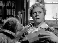 Marius Goring as Sir Percy Blakeney with his dog Sheila