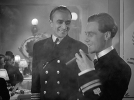 Conrad Veidt as Captain Ernst Hardt & Marius Goring as Lt Felix Schuster. Felix wants to savour his first cigar after 16 days at sea but Hardt persuades him to wait until later ('Food first. Cigar's best after dinner')
