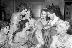 Marius Goring and his female co-stars in a behind-the-scenes photo