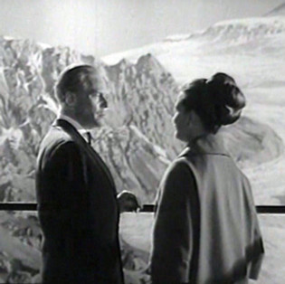 Marius Goring as Colonel Dimonella and Joanna Dunham as Nina Dimonella in The Third Man Season 5 Episode 1 'A Question in Ice'. When the body of Italian partisan who was last seen with Harry Lime during World War II is discovered at the end of a glacier, Harry returns to the Alps to face retribution from the agent's former compatriots. Broadcast 27 June 1964
