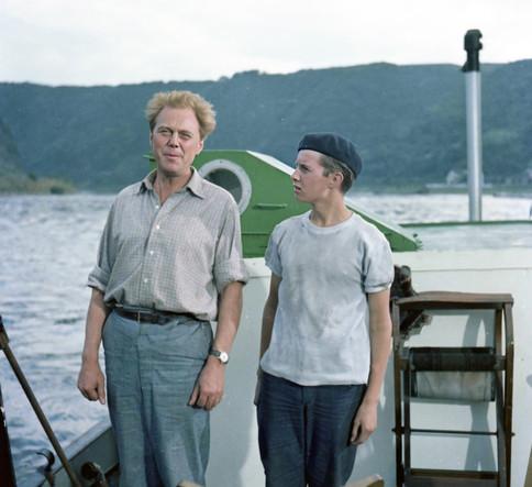 Marius Goring as Georg and Richard Palmer as Derek