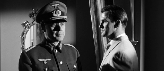 Marius Goring as Colonel Elrick Olberg and Stanley Baker as Conrad Heisler in The Angry Hills 1959