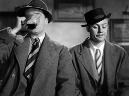 Derrick de Marney as Bill Urquhart and Marius Goring as Charles Barrington