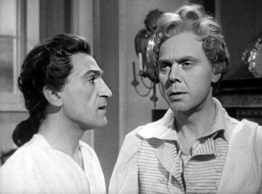 Patrick Troughton as Sir Andrew Ffoulkes and Marius Goring as Sir Percy Blakeney