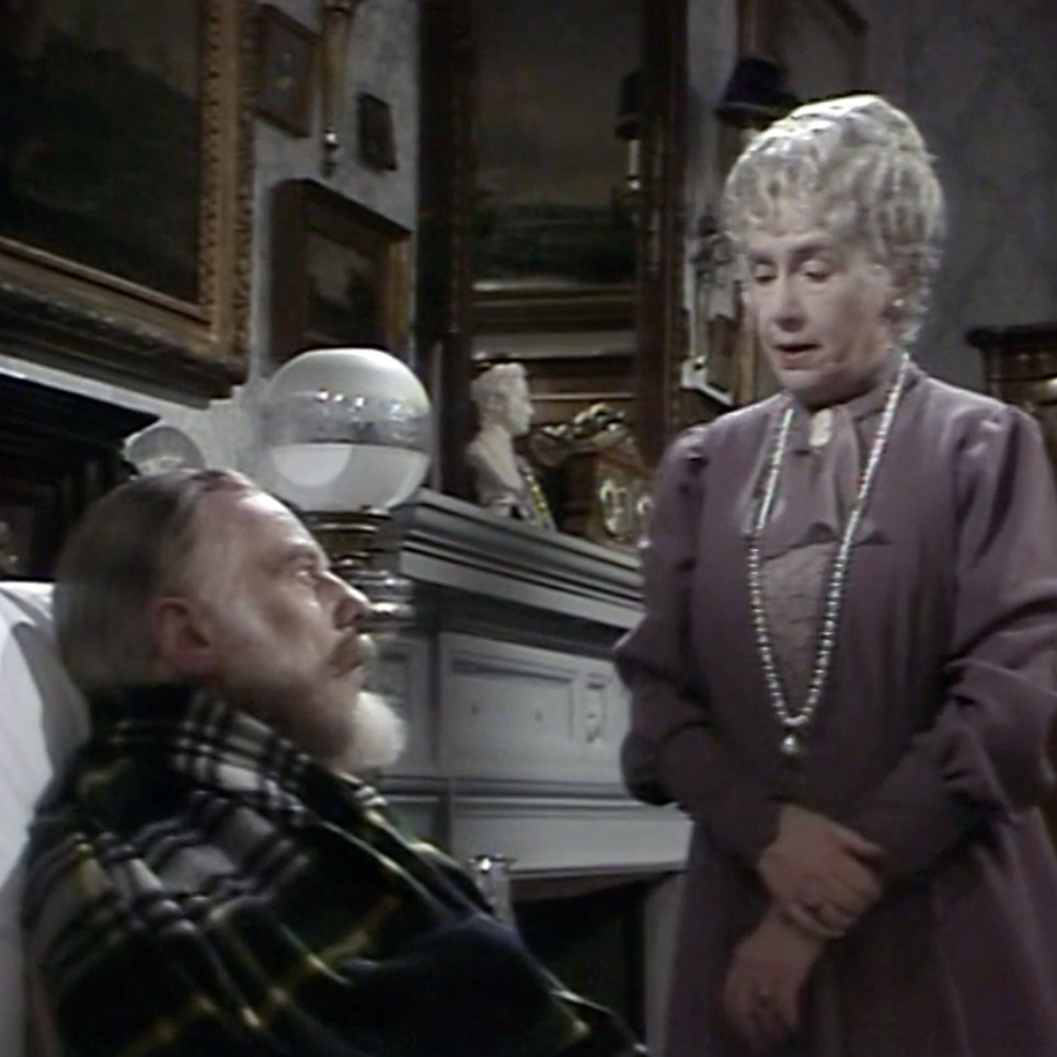Peggy Ashcroft as Queen Mary and Marius Goring as King George V in Edward and Mrs Simpson Part 2 'Venus at the Prow'. Director: Waris Hussein. Writers: Frances Donaldson, Simon Raven. Broadcast 6 November 1978