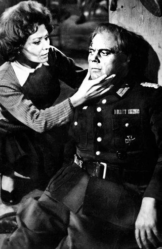 Irina Demick as Lili Rolland and Marius Goring as the German Commander
