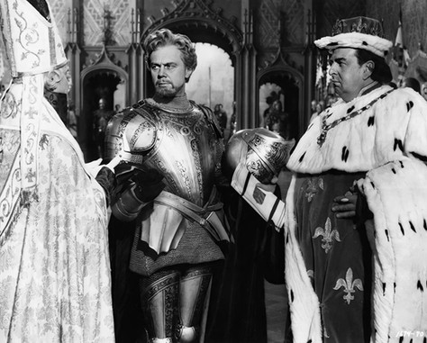 Marius Goring as Count Philip de Creville and Robert Morley as King Louis XI