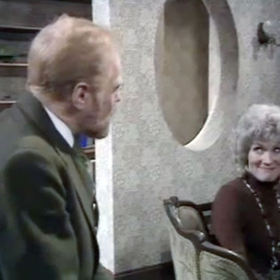 Marius Goring as Professor John Hardy and Virginia Stride as Susan Bartlett in The Expert Season 4 Episode 1 'The Second Appeal'. Directed by Gerard Glasier and written by N.J. Crisp and Gerard Glaister. Broadcast 24 September 1976