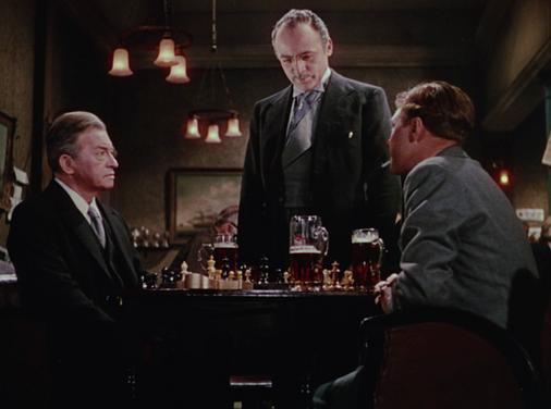 Claude Rains as Kees Popinga, Herbert Lom as Julius de Koster and Marius Goring as Inspector Lucas