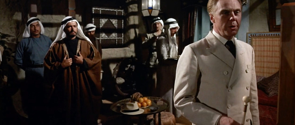 Marius Goring as von Storch and John Derek as Taha