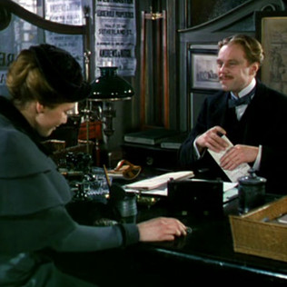 Maria Schell as Helena Friese-Greene and Marius Goring as a house agent