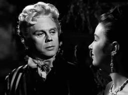 Marius Goring as Sir Percy Blakeney and Maureen Connell as Melanie