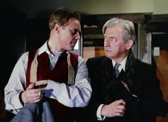 Marius Goring as Inspector Lucas and Claude Rains as Kees Popinga