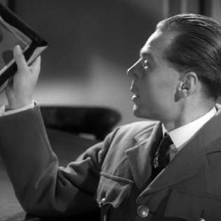 Marius Goring as the German Propaganda Officer