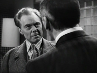 Marius Goring as Inspector Hazelrigg and Cameron Mitchell as James Kennedy