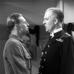 Marius Goring as the German Propaganda Officer and Austin Trevor as the U-boat Captain