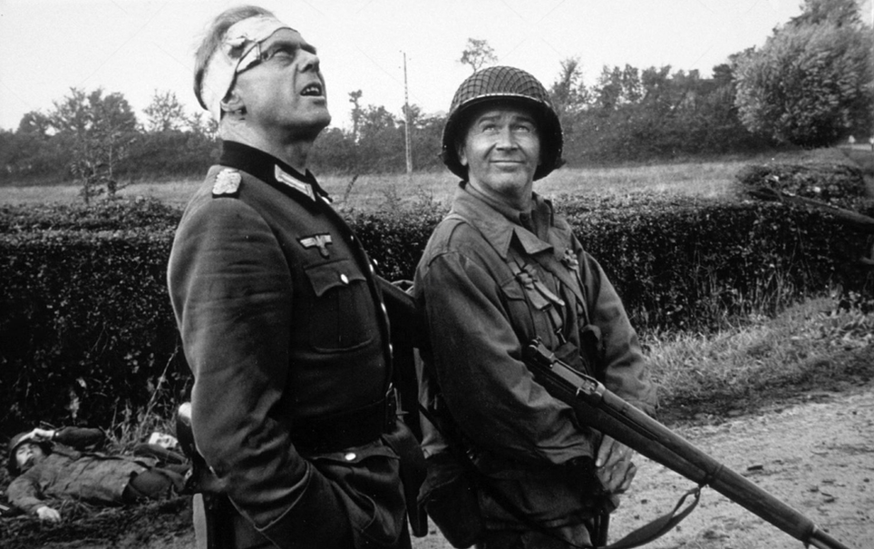 Marius Goring as the German Commandant and Red Buttons as PFC Harry Devine