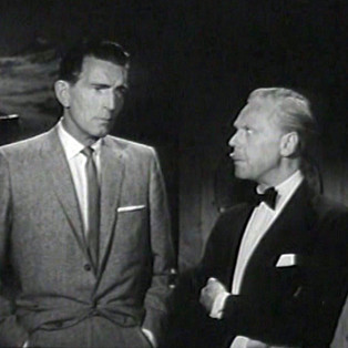 Michael Rennie as Harry Lime and Marius Goring as Colonel Dimonella in The Third Man Season 5 Episode 1 'A Question in Ice'. When the body of Italian partisan who was last seen with Harry Lime during World War II is discovered at the end of a glacier, Harry returns to the Alps to face retribution from the agent's former compatriots. Broadcast 27 June 1964