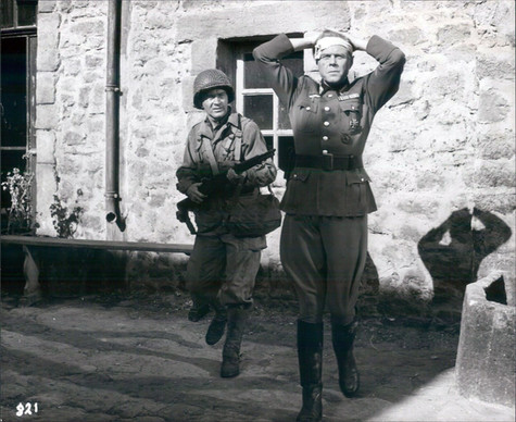 Red Buttons as PFC Harry Devine and Marius Goring as the German Commandant