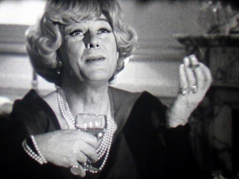 Marius Goring as Mme Sacramento in Les Dossiers de l'Agence O