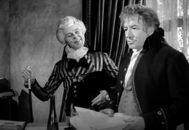 Marius Goring as Sir Percy Blakeney and Stanley Van Beers as Chauvelin