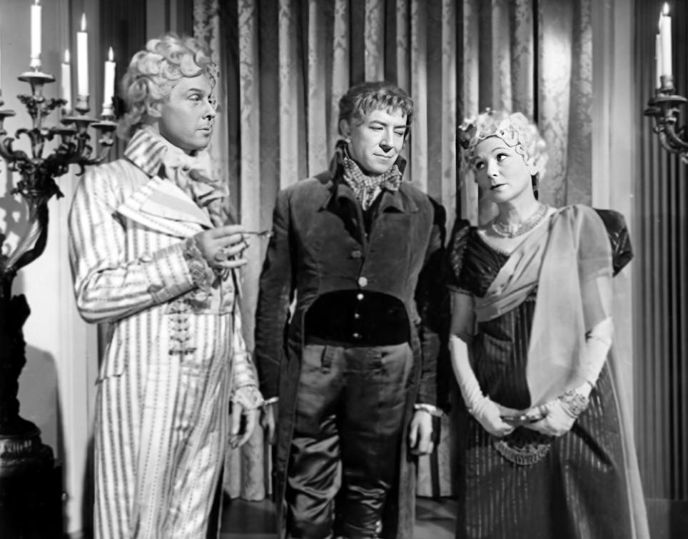 Marius Goring as Sir Percy Blakeney, Stanley Van Beers as Chauvelin and Lucie Mannheim as the Countess la Valliere