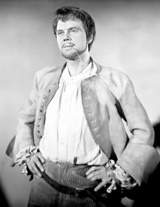 Marius Goring as Sir Percy Blakeney/The Scarlet Pimpernel in disguise as Pierre Duclos
