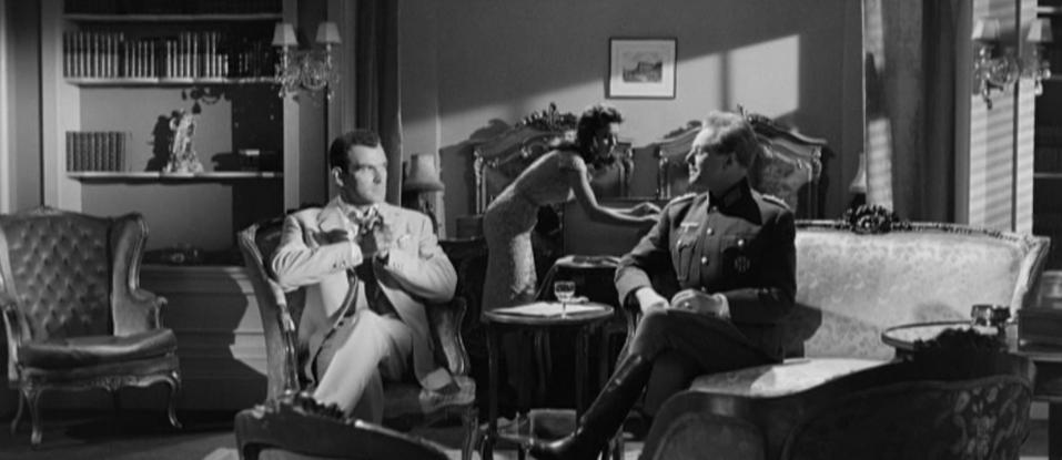 Stanley Baker as Conrad Heisler and Marius Goring as Colonel Elrick Oberg