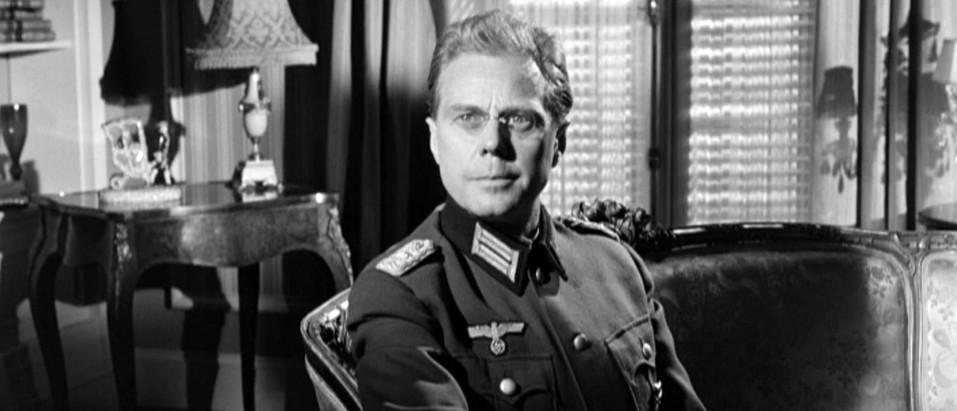 Marius Goring as Colonel Elrick Oberg