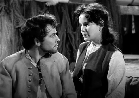 Marius Goring as Sir Percy Blakeney/The Scarlet Pimpernel in disguise as Pierre Duclos and Susan Lyall Grant as Ginette