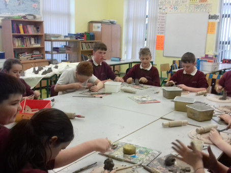 5th & 6th class are working  with clay in art class. They enjoyed sitting together while sculpti