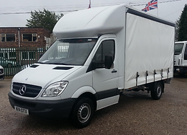Luton van with curatinside and tail lift