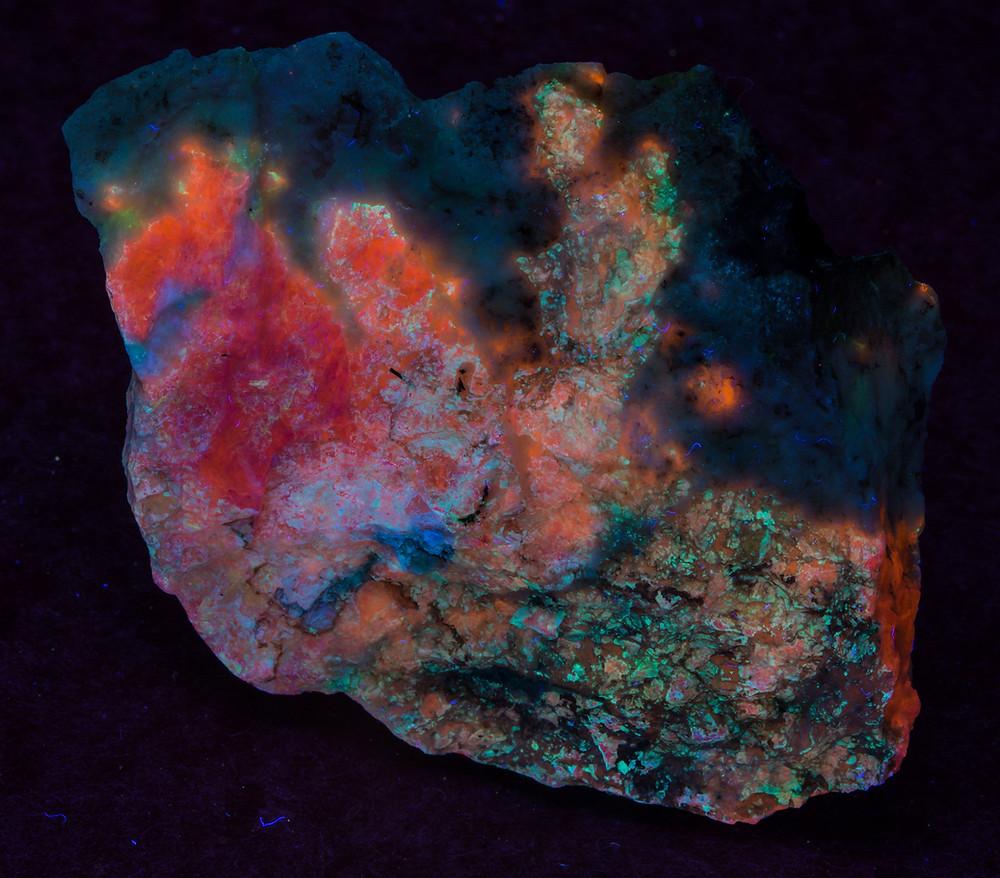 Red Sodalite under shortwave UV - Greenland