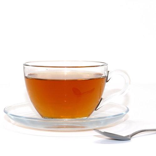 glass tea cup and saucer
