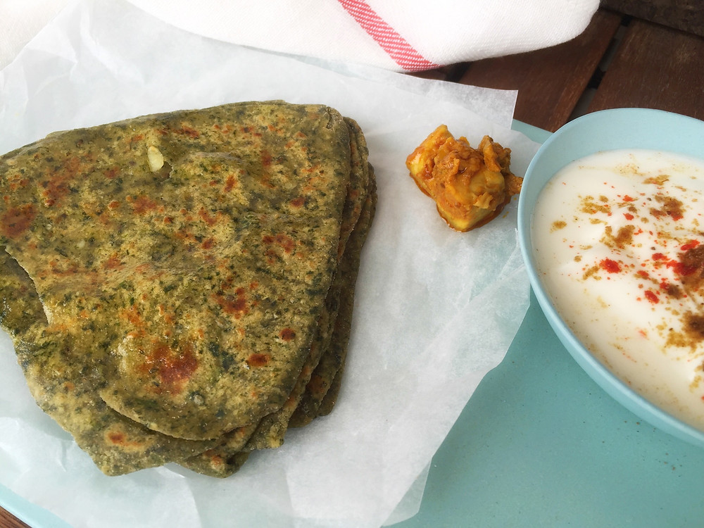 Spinach Paratha, served with raita and mango pickle