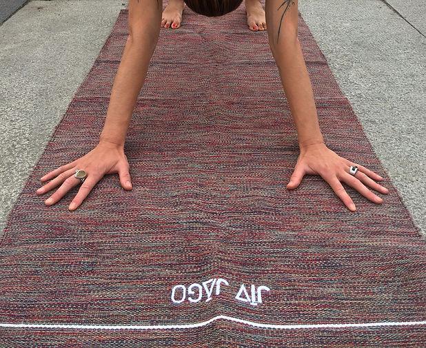 hands on a yoga rug