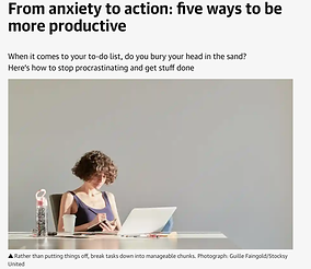 A woman sitting in front of a laptop looking anxious